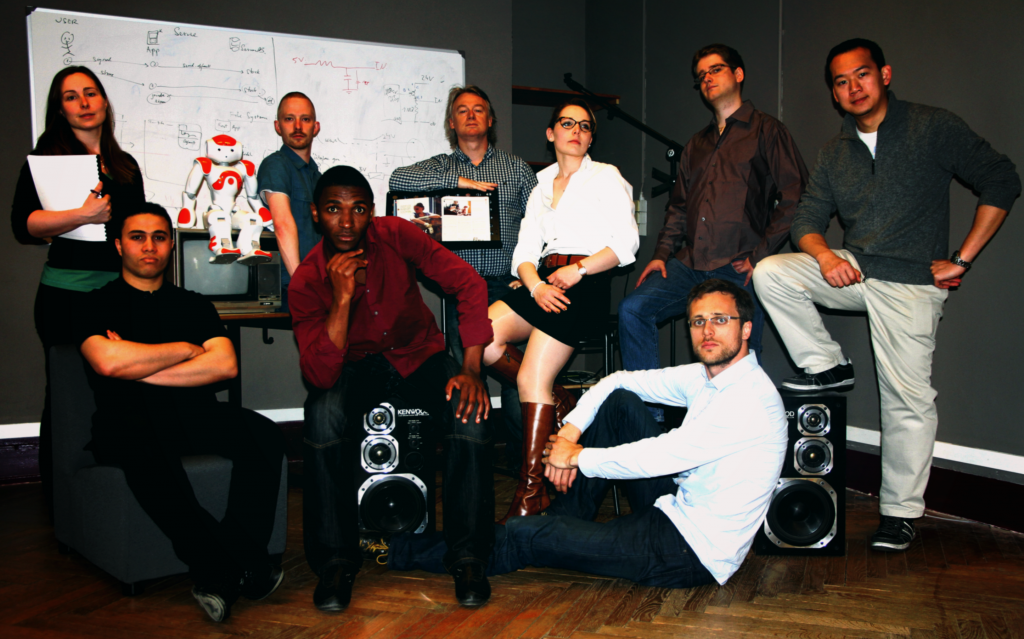 Team InterFaceOff! Alexandra, Mohamed, Steve, Herman, Rudi, Aurore, Damien (seated on floor), Jean-Guillaume, Minh and robot, Nao!